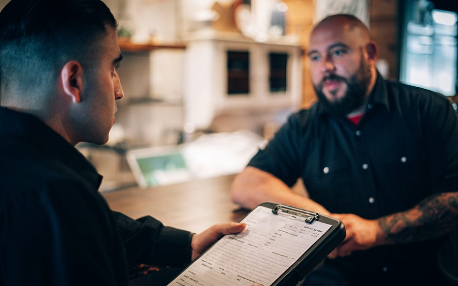 Vancouver Pest Control Specialist Discussing the Infestation Problems With the Client | Phantom Pest Control Vancouver